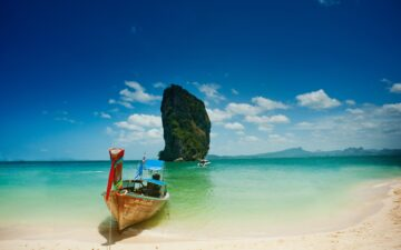 Why do people go to Thailand?